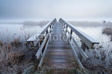 wooden bridge via river in winter 102600994