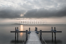 Wooden pier on the lake. Fog. Sunset in pastel colors. Long exposure. 100839686
