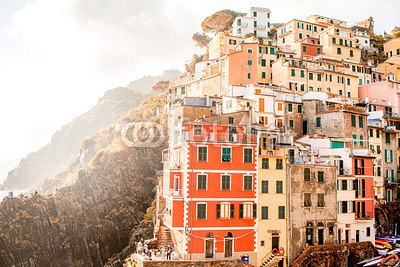 Riomaggiore old town with colorful buildings on the coastal hill in a small valley in the Liguria region of Italy 119629511