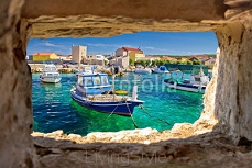 Razanac turquoise waterfront through stone window 116354421