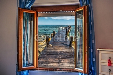 pier seen through an open window 118409348