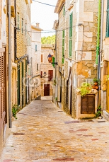 View of a alleyway of a old spanish village with rustic houses  103234153